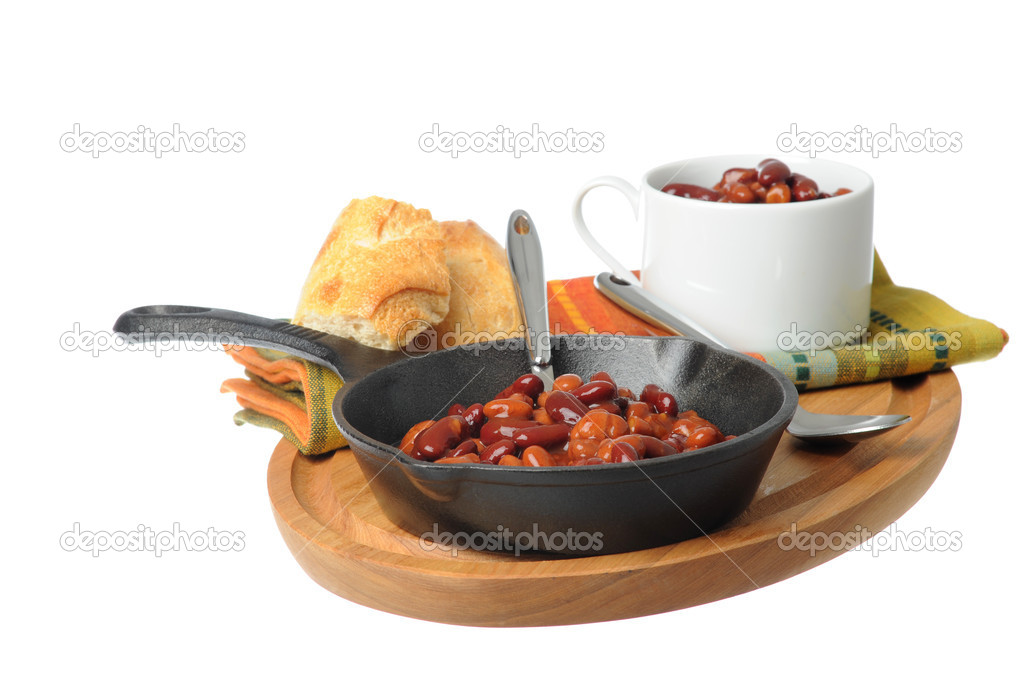 Skillet of delicious and spicy baked beans.  Stock Photo #4413182