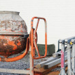 Small, rusty concrete mixer - Foto Stock