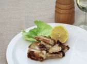 Fried sea eel with lemon and glass of white wine — Stock Photo