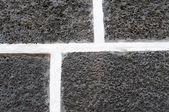 Blanco y negro patrón de ladrillos volcánicos — Foto de Stock
