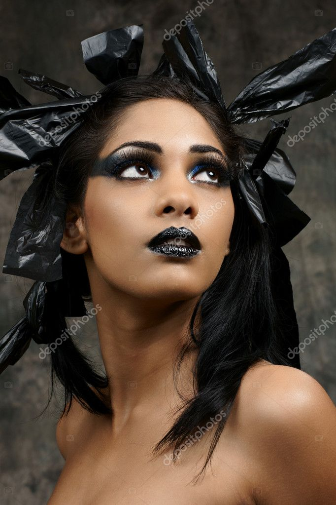 An edgy gothic dramatic Halloween makeup of a beautiful young woman of East Indian Ancestry  — Stock Photo #3993379