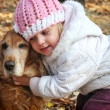 Girl and dog — Stock Photo