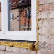 Installing plastic window — Stockfoto