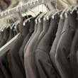 Stock Photo: Suit department in boutique