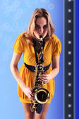 Woman with saxophone. — Stock Photo