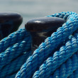 Stock Photo: Bollard and blue rope