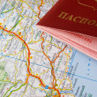 Passport and a europe road map - Stock Photo