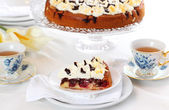 Cherry sponge cake with cream — Stock Photo