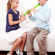 Kids playing flute - Stock Photo