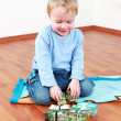 Lovely boy playing with blocks — Stock Photo #4523373