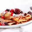 Crepes filled with chocolate and berries - Stock Photo
