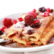 Stock Photo: Crepes filled with chocolate and berries