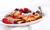 Crepes filled with chocolate and berries — Stock Photo