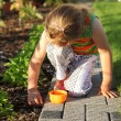 Child helping in garden - Stock Photo