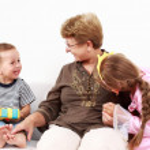 Happy kids with grandma — Stock Photo