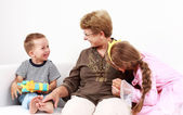 Happy kids with grandma — Stock Photo