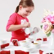 Girl helps to set table — Stock Photo