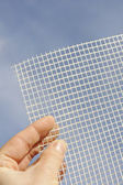 Detail of glass-fiber mesh in hand — Stock Photo
