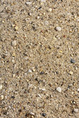 Detail van zand textuur met kleine steentjes - achtergrond — Stockfoto