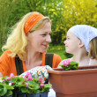 Stock Photo: Mother and daughter having gardening time