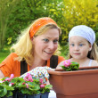 Mother and daughter having gardening time — Stock Photo