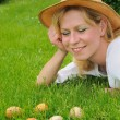 Young woman and easter eggs on the grass - Easter time — ストック写真