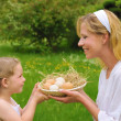 Mother and daughter holding fresh eggs — Stock Photo