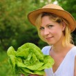 Young woman holding fresh lettuce — Stock Photo