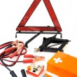 Emergency kit for car - first aid kit, car jack, jumper cables, warning tri — Stock Photo #5211785