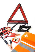 Emergency kit for car - first aid kit, car jack, jumper cables, warning tri — Foto de Stock
