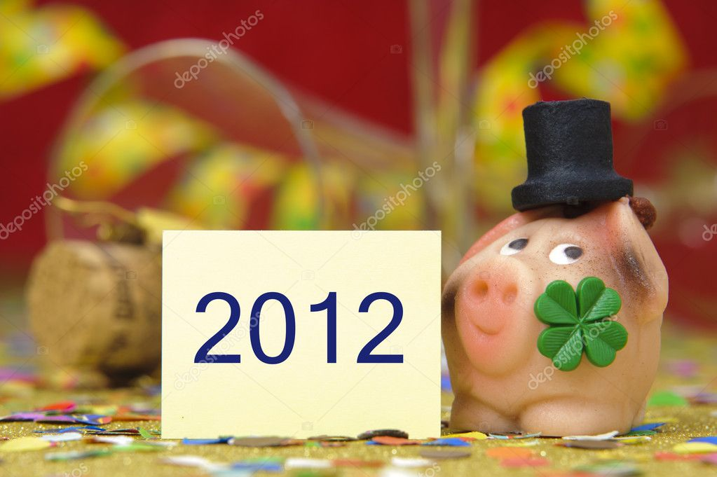 happy new year 2012 with lucky pig and clover leaf — Stock Photo #4721644