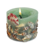 Candle spa with shells — Stock Photo