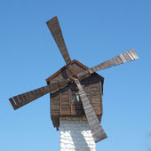 Antique ramshackle wooden windmill — Stock Photo