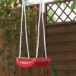 Red swing — Stock Photo