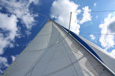 Yacht sail and mast with sky — Stock Photo