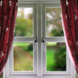 Window with curtains and a shallow depth of field - Stock Photo
