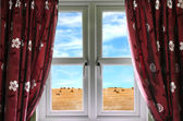 Window and curtains with view of crops — Stock Photo