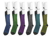 Row of socks on pegs — Stock Photo