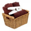 Rolled towels in a basket isolated - Stock Photo