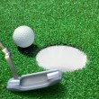 Stock Photo: Golf ball on green course