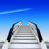 Frontal view of white ramp in airport and fly away plane — Stock Photo