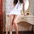 Sexy brunette in bedroom - Stok fotoraf