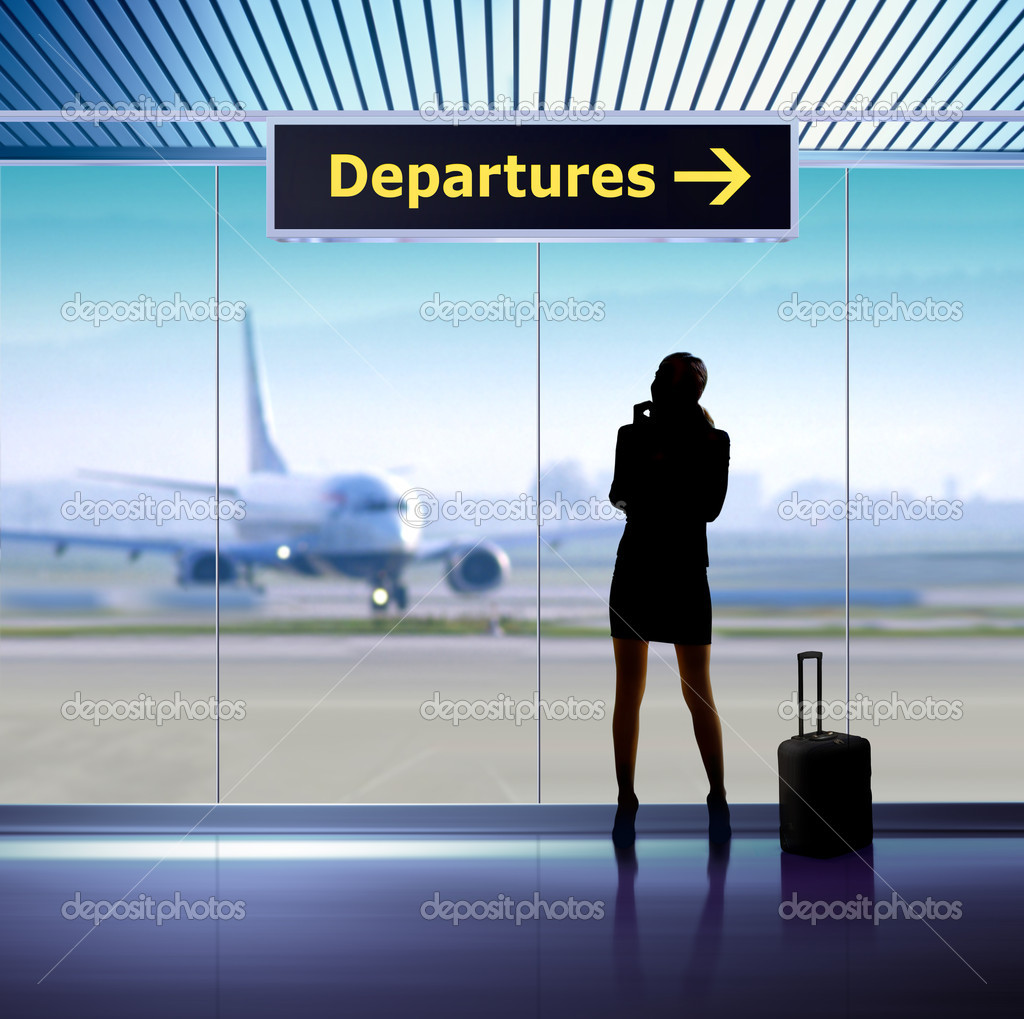 Tourist info signage in airport and silhouette of passenger — Stock Photo #4305390