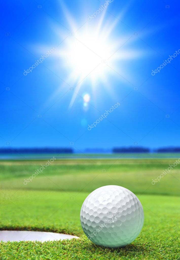 Golf ball on green course near the bunker — Stock Photo #4418881