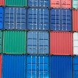 Multi-colored freight shipping containers at the docks — ストック写真