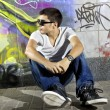 Man in front of graffiti wall — Stock Photo