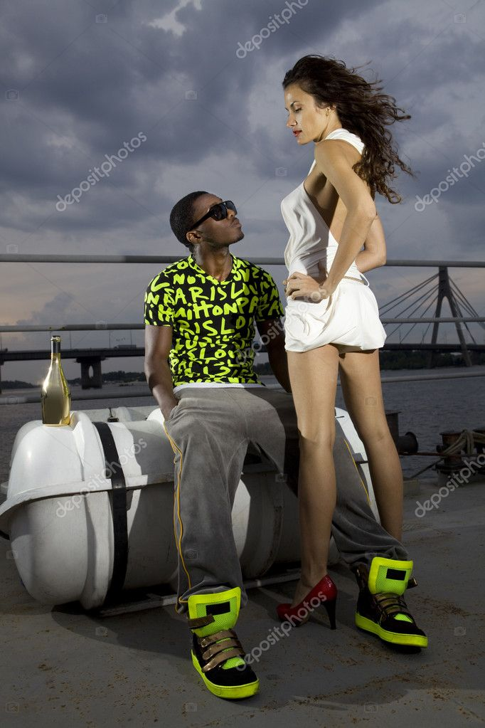 Couple of lovers in harbour at night, afro-american man and caucasian woman — Stock Photo #4722231