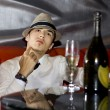 Man drinking champagne - Stock Photo