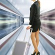 Business traveler with luggage - Stock Photo