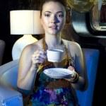 Woman drinking tea in restaurant — Stock Photo
